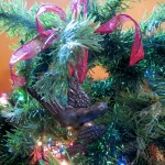 You can tie a bright, sparkling bow on and give this birdie a different tree to roost in.