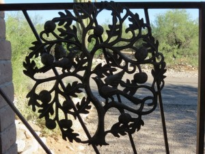 Wire a tree of life to your iron gate.  Nice!
