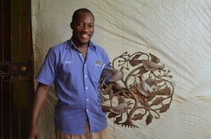 Cineus Louime, with one of his beautiful tree of life designs.