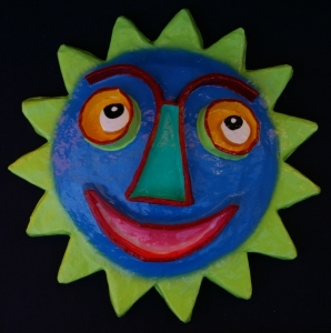 A cheerful sun face in bright colors such as these create a light-hearted visual punch.