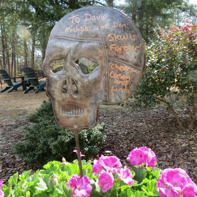 Autographed skull garden stake
