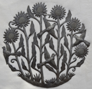 Lovely floral scene struck in metal by Haitian artist, Charles Luthene