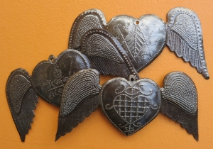 These winged hearts, by Wiseton Brutus, are adorned with veves.