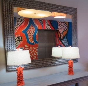 Louis-Prospere inspired elevator surround and Haitian recycled metal mirror frame.