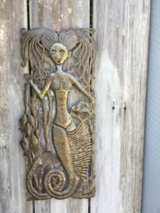 Giving as explained by a mermaid sculpture.