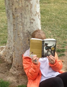 "Reading ""Black Count,"" by Tom Reiss under a tree"
