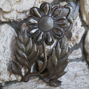 Recycled metal art on stone