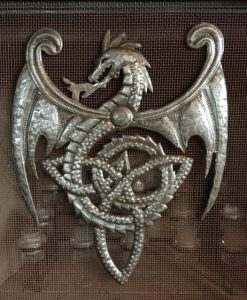 Celtic inspired dragon with tail worked into a trinity knot